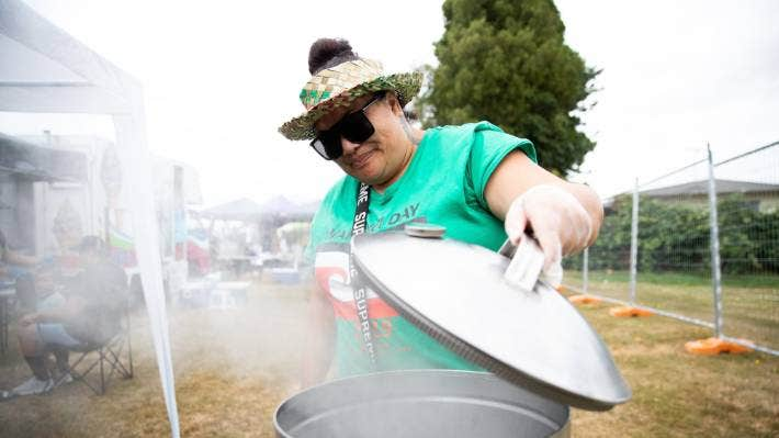 Tui Kirkwood checks her hangi at the Waitangi Day events at Western Community Centre, Nawton. The Hamilton event received $2000 this year.