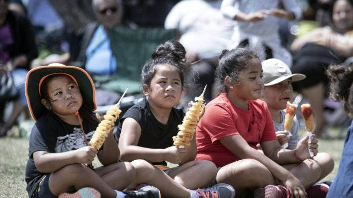 Cultural performances at Porirua's Waitangi Day commemorations, and food, captivate youngsters.