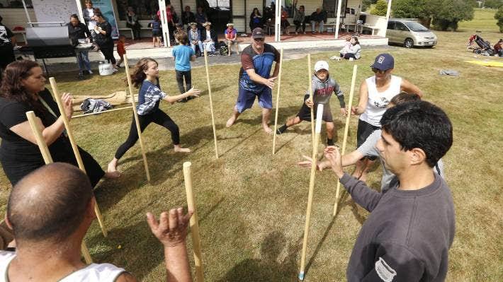 Participants learn taiaha at a whānau fun day hosted by Te Aitarakihi Trust and Aoraki Migrant Centre.