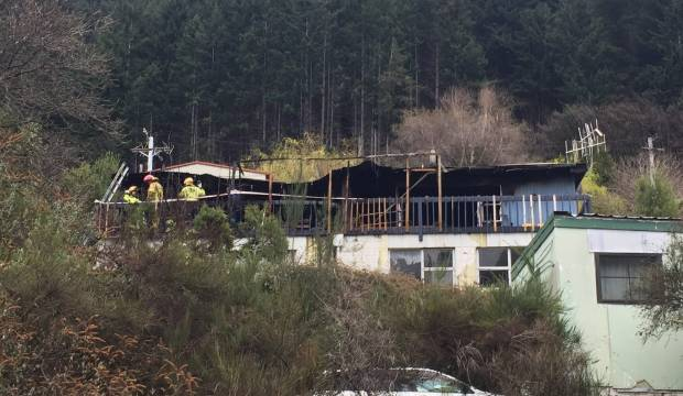 Fire engulfs apartment building in Queenstown, one person taken to hospital