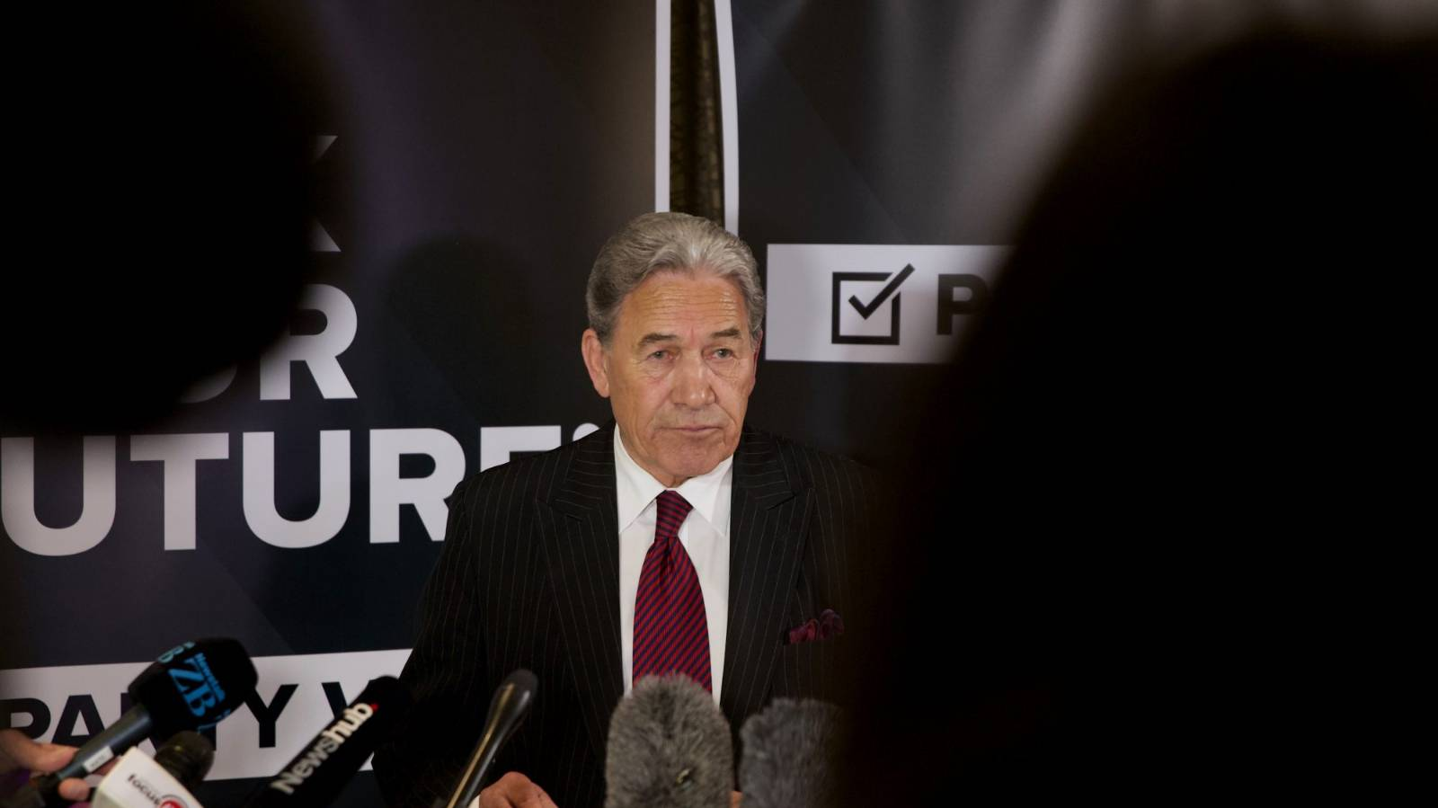Peters threatens to take SFO to court as two charged over NZ First Foundation