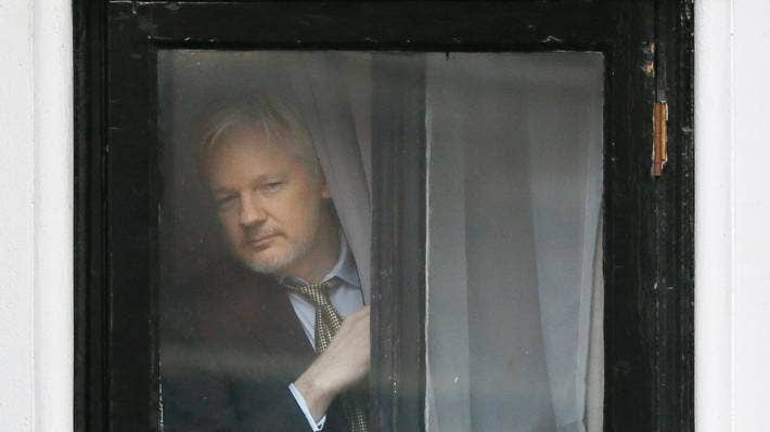 Wikileaks founder Julian Assange appears at the window before speaking on the balcony of the Ecuadorean Embassy in London, back in 2016.
