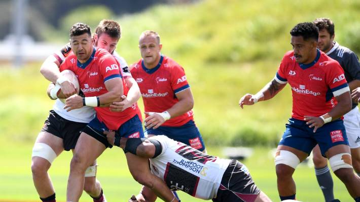 Tasman captain David Havili isn't going far as North Harbour nail him down during the Mitre 10 match in Albany.