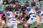 Akira Ioane shows North Harbour's Jacob Pearce that there's no chance of going through him to beat the Auckland defence.