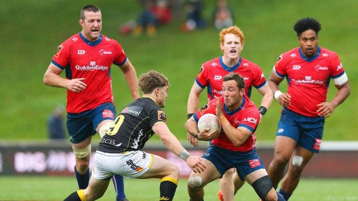Mitch Hunt of Tasman has team-mates in close attendance against Wellington.