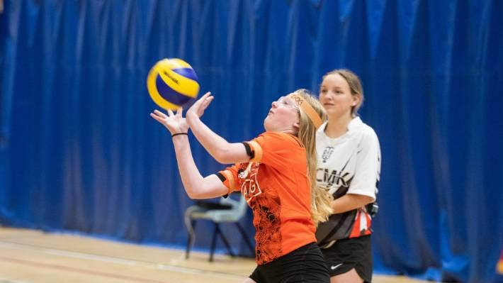 Charlotte Lavery, 14, of Sacred Heart Girls College sets the ball for her team-mate.