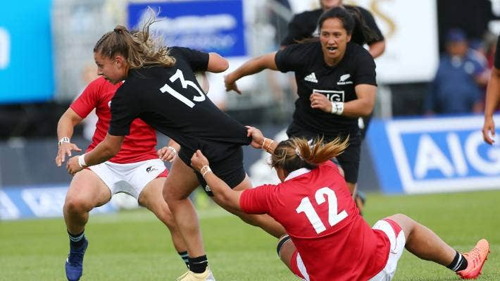 Black Ferns centre Amy du Plessis being dragged down by the Barbarians.