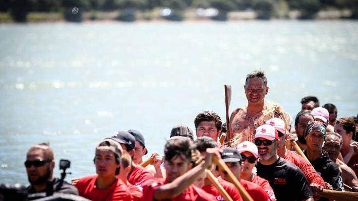 A waka ama crew on Te Awarua-o-Porirua. Waka racing was popular with Māori prior to European settlement.