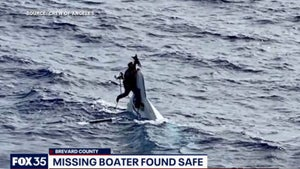 Missing man found clinging to capsized boat 136km off US coast