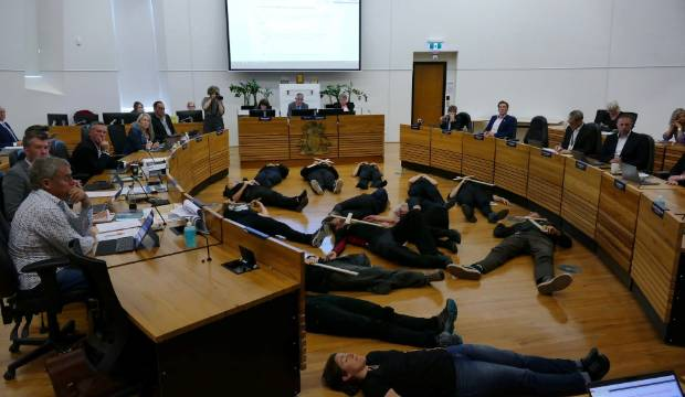 Protesters play dead in front of councillors to oppose proposed new airport