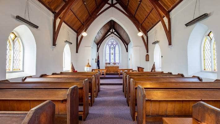 The church was built in a traditional English style, with an arch-braced timber ceiling and oak altar.