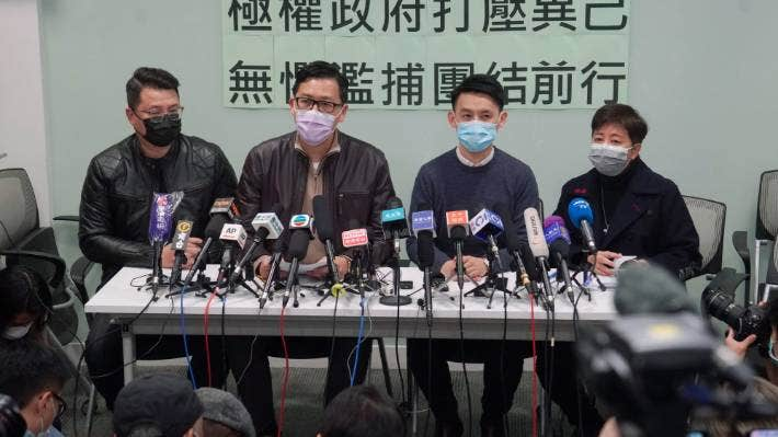 Former Democratic Party legislators Andrew Wan, left, Lam Cheuk-ting, second left, and Helena Wong, right, attend a press conference after being released on bail in Hong Kong on Friday.