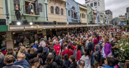 Hundreds of people packed Christchurch's New Regent St on Saturday for to watch circus performers, opera singers, an ...