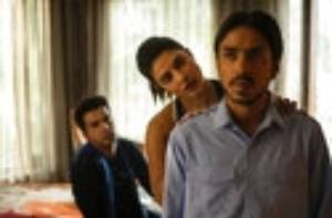 This image released by Netflix shows Rajkummar Rao, from left, Priyanka Chopra and Adarsh Gourav in a scene from ...