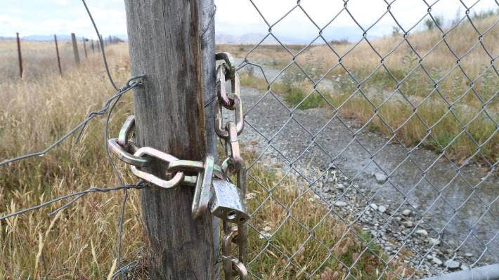There is currently a single padlock on the gate into the pit, barring use for everyone.