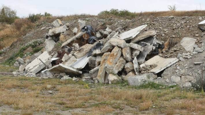 Concrete and rubbish in the Pukaki Airport pit.