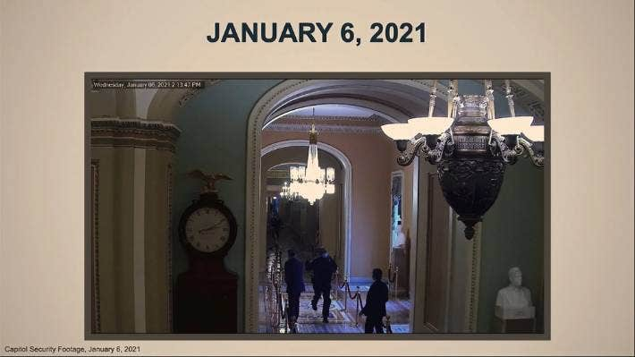 In this image from video, a security video shows US Capitol Police officer Eugene Goodman running past Senator Mitt Romney.