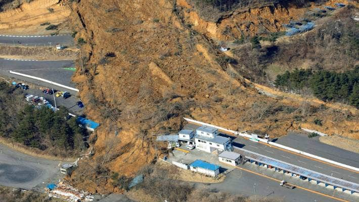 A landslide caused by a strong earthquake covers a circuit course in Nihonmatsu city, Fukushima prefecture, northeastern Japan.