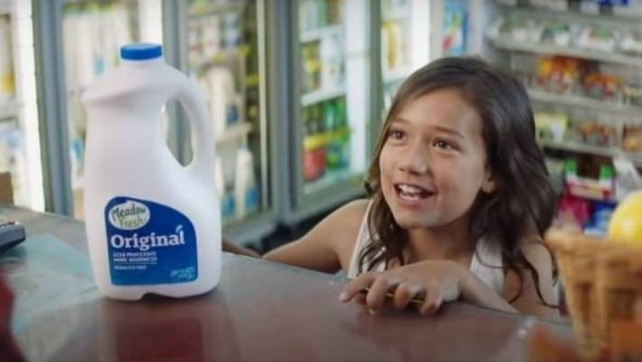 The Meadow Fresh ad showed a girl going to the dairy by herself for the first time to buy some milk. Another version, pictured, showed the girl walking to the dairy.