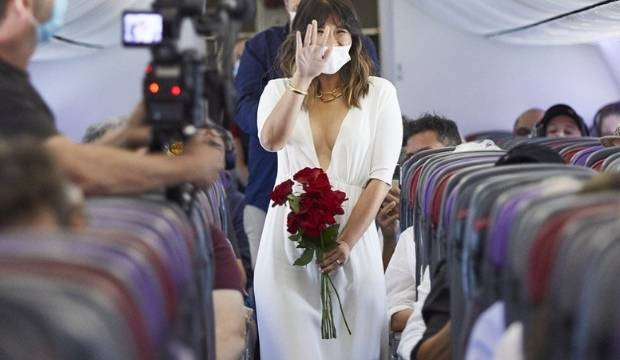 Saying 'I do' in front of shocked strangers: Getting hitched at 40,000 feet