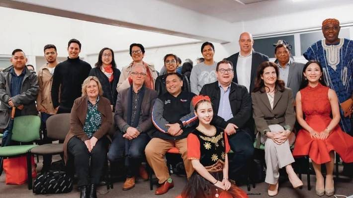 Wellington MPs pictured with members of the China Cultural Centre, and a Han Chinese dancer dressed as a Uyghur Muslim, in 2020.