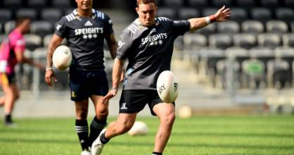 Mitchell Hunt practises his kicking as Aaron Smith looks on at Forsyth Barr Stadium on Wednesday.