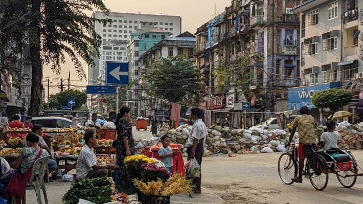 Life carries on in Yangon amidst the barricades.