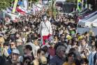 Martin Ewen aka 'Lurk', wanders through the huge crowd on Riddiford St at the Newtown Festival on Sunday.