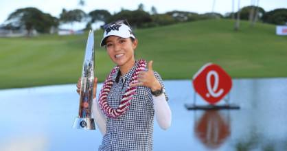 Lydia Ko holds the Lotte Championship trophy after winning her first title in almost three years.