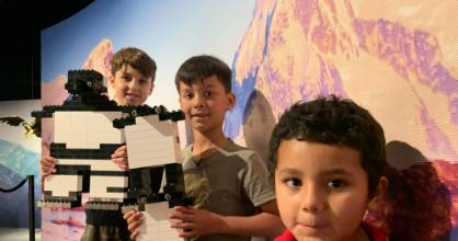 "Tavius, James and Samuel immerse themselves in the Lego world at a ""quiet session"" at the Brickman exhibition in Auckland."