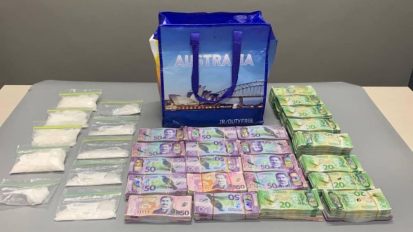 Cash and drugs worth $450k seized after car crash