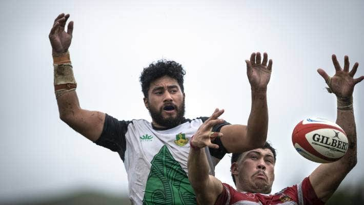 Marist and Waimea locks get some altitude as they contest the linout on a wet Nelson Saturday.