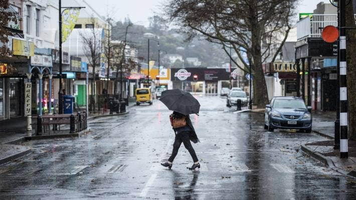 A pedestrian navigates their way to work in central Nelson during rain on Monday, with more expected through the day.