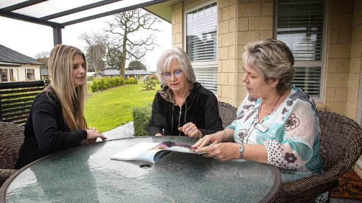 Speldhurst Lifestyle Village manager Fiona McGregor, left, resident Jill Smith and sales manager Debra Bishop at one of the three-bedroom homes.