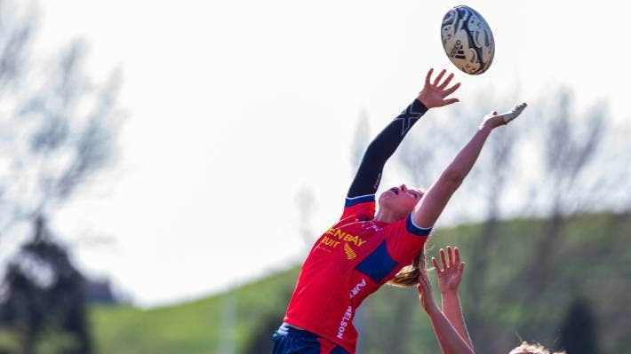 Tamara Silcock reaching for the ball in a lineout.