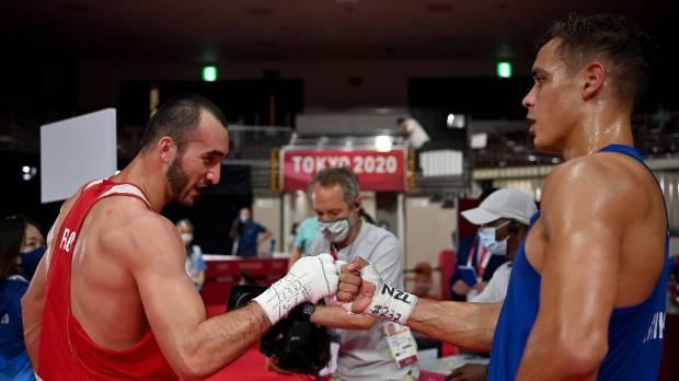 Muslim Gadzhimagomedov and David Nyika embracing after their semifinal clash in Tokyo.