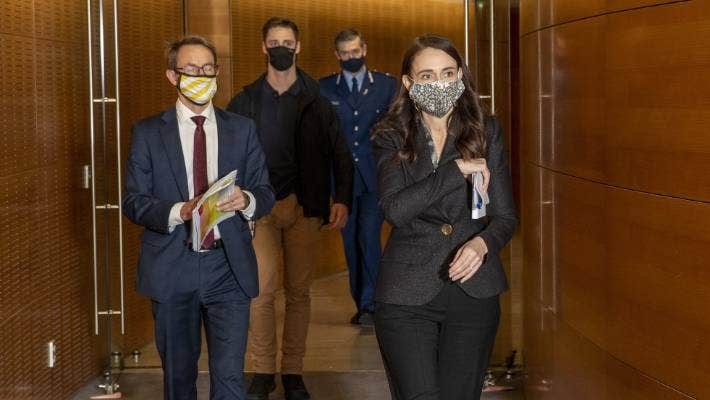 Prime Minister Jacinda Ardern and Director General of Health Dr Ashley Bloomfield arrive at a press conference with Police Commissioner Andrew Coster