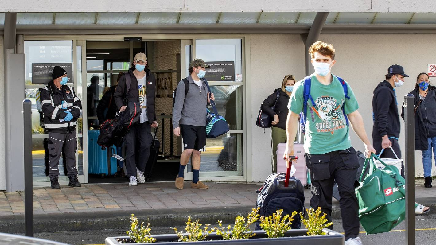 Relieved reunions at Palmerston North Airport as travellers rush to beat 48-hour deadline