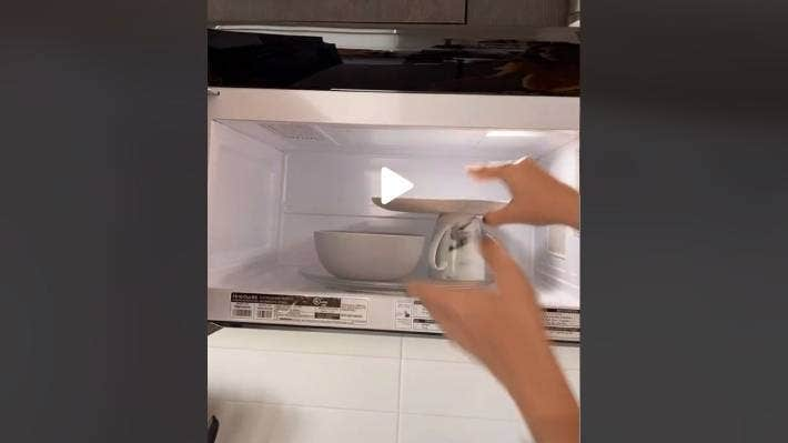 OnlyJayus TikTok shows adding a mug to put a plate on also helped heat two things at once.