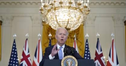 President Joe Biden, joined virtually by Australian Prime Minister Scott Morrison and British Prime Minister Boris ...
