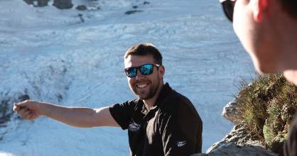 Dan Harrison, pictured on a glacier entertaining Over The Top clients, died in a helicopter crash in Otago this week.