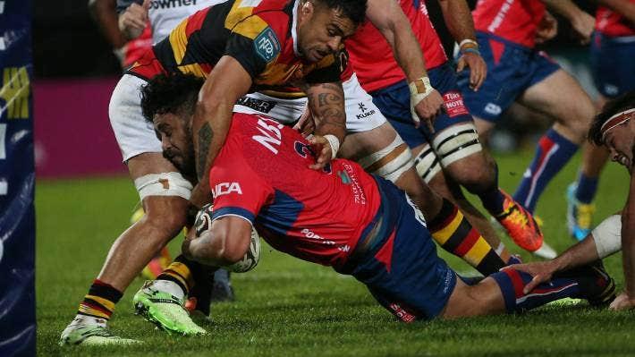 Waikato loose forward Liam Messam holds up Tasman player Sam Matenga in Nelson on Friday night.