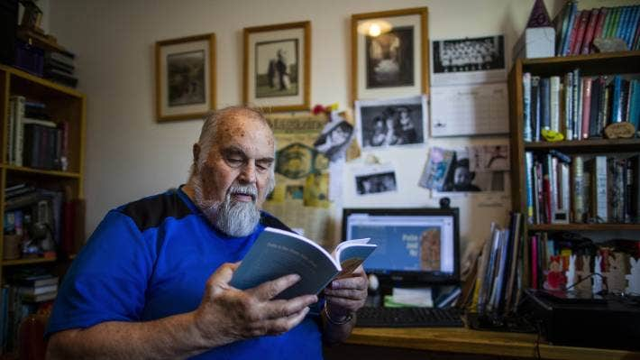 Palmerston North writer Mervyn Dykes in 2018 with his just realised book Polio and Me.