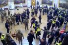 In this image from US Capitol Police security video, police and rioters are seen in the Rotunda of the Capitol on ...
