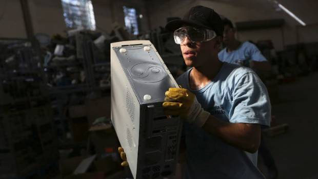 TRASHED: A worker at an e-waste disposal centre in Sao Paulo, Brazil.