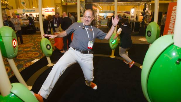 Michael Laris and Tracey Cassidy play the Neos 360 'Light Grabber' game by Playworld Systems during the 2014 ...
