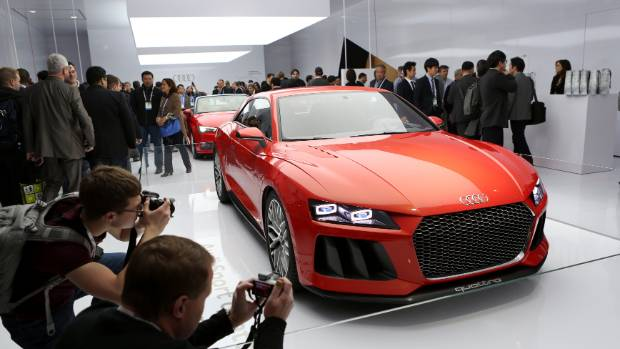 Conference attendees take photographs of the Audi Sport Quattro laserlight concept car, featuring laser headlights, at ...