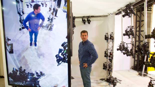 Inside a Nikon-powered XXArray during at CES 20414. The booth uses 68 cameras that fire at the same time. The images are ...