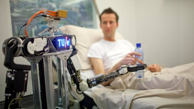 YOU WANT SOME MORE? A robot connected to RoboEarth serving a drink to a patient.