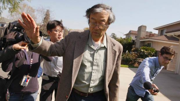 EXPOSED: Satoshi Nakamoto is surrounded by reporters as he leaves his home in Temple City, California.